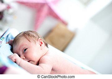 Cute inquisitive newborn baby