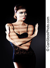 enigma lady - Elegant young woman in black lingerie posing...