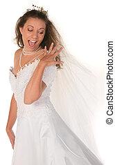 Happy Bride Looking at Her Diamond Ring - Happy Bride...