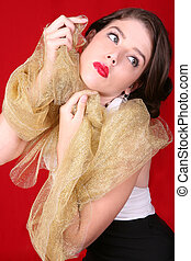 Beautiful Woman Holding Gold Fabric Against Her Face -...