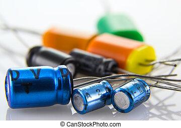 electrolytic capacitors in metal and plastic housings of...