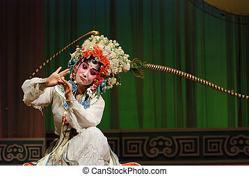 pretty chinese opera actress performs on stage.