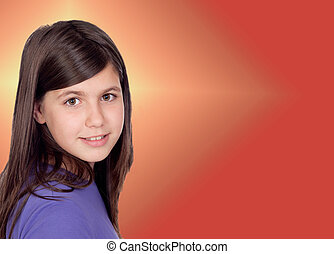 Adorable preteen girl with a orange and yellow background