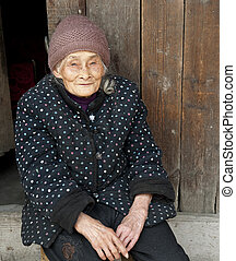 portrait of 90 years old woman in a town