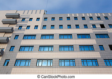 Blue windows - Wall of a modern many-storeyed building with...