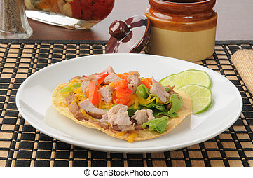 Pork carnita tostada - A pork carnita tostada with salsa and...