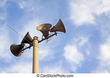 loudspeaker in the blue sky