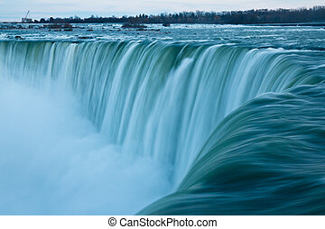Niagara Falls - Water rushes over the edge of the Horseshoe...