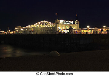 Brighton Pier - Night view of the Brighton Pier, a popular...