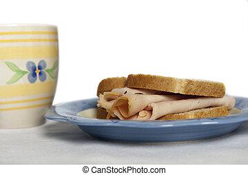 Turkey sandwhich - Closeup of a turkey sandwich on a...