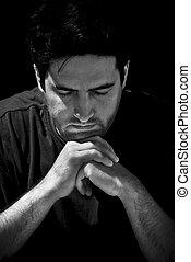 Man in prayer - BW