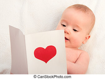beautiful baby and postcard Valentine's Day with a red heart...