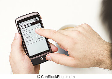 Man checks Mobile Banking details on a Smartphone