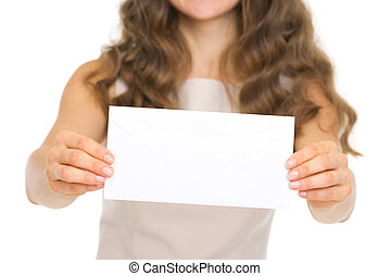 Closeup on woman giving envelope