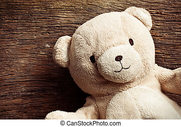 teddy bear on old wooden background