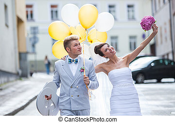 Walking on a wedding day - Young couple walking on their...