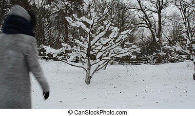woman shake tree snow