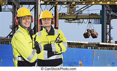 Two dockers at an Industrial Harbor - Two dockers, coworkers...