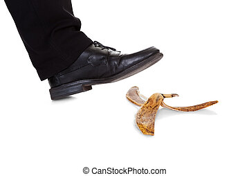 Businessman slipping on banana peel Isolated on white