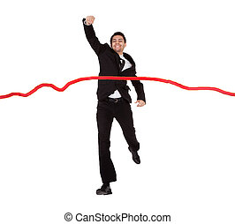 Businessman running through finishing line Isolated on white...