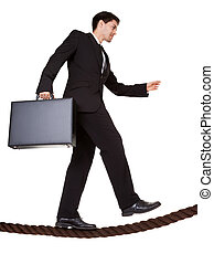 Businessman walking a tightrope - Conceptual image of a...