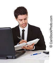 Businessman making a note in his diary