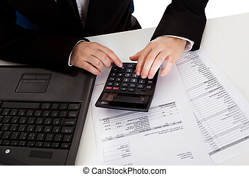 Accountant doing calculations - High angle cropped view of...