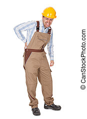 Workman with a back injury grimacing and clutching his lower...