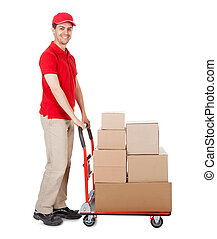 Deliveryman with a trolley of boxes - Cheerful young...