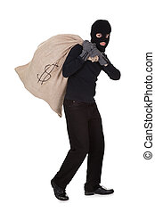 Thief carrying a large bag of money - Thief in black clothes...