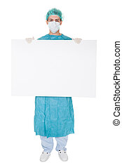 Surgeon holding up a blank banner