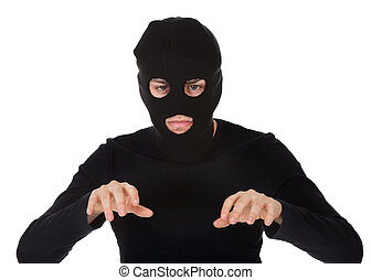 Thief wearing a balaclava dressed in blacked moving...