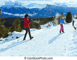 Family plays at snowballs on winter mountain slope - Family...