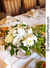 Flower decorations on the banquet table, prepared for event...
