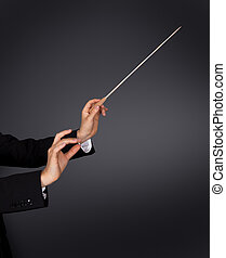 Music conductor with a baton - Closeup of the hands of a...