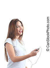 Woman listening to the music with headphones - Woman singing...