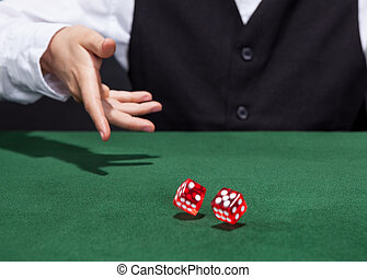 Croupier throwing a pair of dice - Croupier throwing a pair...