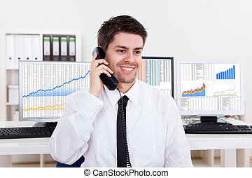 Stock broker in a bull market - Enthusiastic young male...