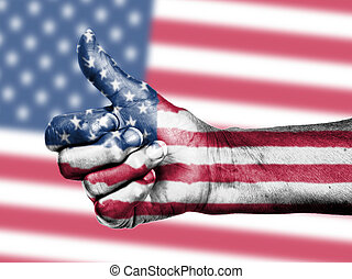 US flag on thumbs up hand isolated on a flag background