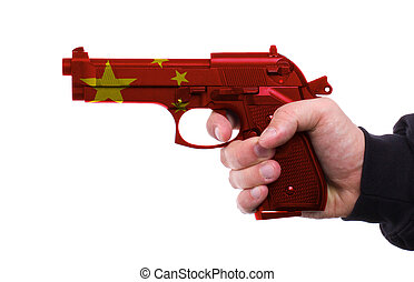 Pistol with chinese flag pattern in hand, isolated on white...