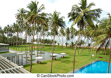 The swimming pool and beach of luxury hotel, Bentota, Sri...