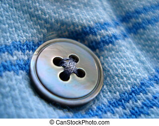 Blue Button - A single blue button on a cotton shirt.