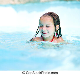 Little girl at aquapark - Little girl on water slide at...