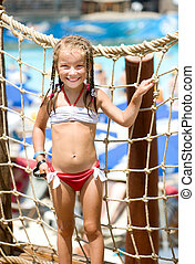 Little girl at aquapark - portrait of a little girl aquapark...