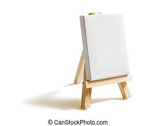 Blank canvas on easel isolated on white background - Empty...