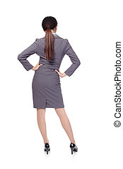 Business woman from the back - looking at something isolated...