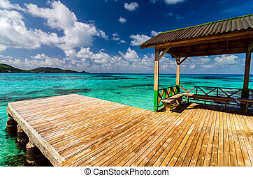 Dock in Turquoise Water - Wooden dock in beautiful blue and...