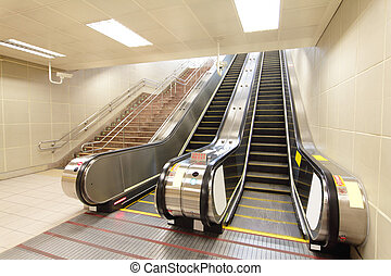 The escalator moving at metro station - The escalator moving...