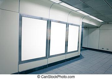 Blank billboard in metro station - Blank billboard with copy...