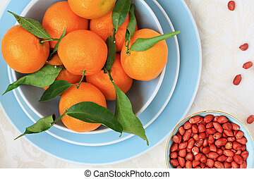 Ripe clementines and red skin pinuts - Ripe clementines on...